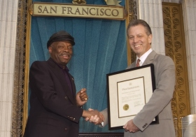 "On the occasion, San Francisco Mayor Willie Brown (left) presented the Church with a proclamation commending ""its efforts in making the Bay Area a better place for persons of all races, colors, creeds and walks of life."""